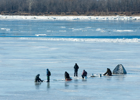tatarstan: River flood fishermen. Torn river ice fishermen. River with the last ice fishermen on the ice. Russia Tatarstan Kama river in early spring