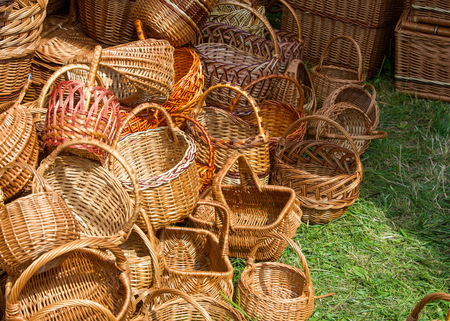 osier: baskets woven from willow twigs. a container used to hold or carry things, typically made from interwoven strips of cane or wire.