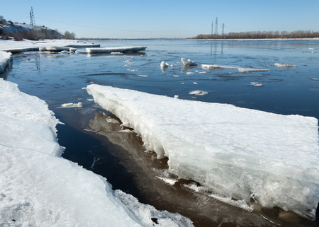 River With Broken Ice. energy pillars.  ice hummocks on the river in spring. landscape close-up ice drift on the river in the spring on a sunny day Stock Photo