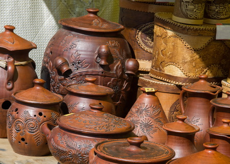 skill: Texture, background. Pottery. pots, dishes, and other articles made of earthenware or baked clay. Pottery can be broadly divided into earthenware, porcelain, and stoneware. Stock Photo