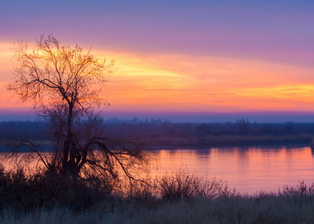 Spring. river. sunrise. sunset.  Dawn over the river photographed in early spring Stock Photo