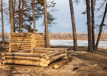 early spring, construction of wooden houses, the river ice.