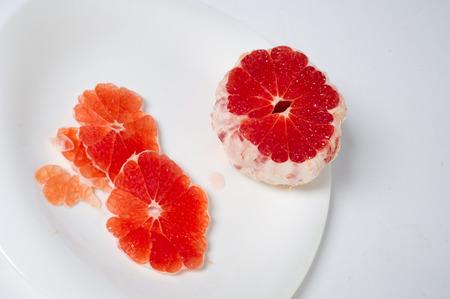 grapefruit. big, round, yellow citrus fruit with an acid, juicy pulp.