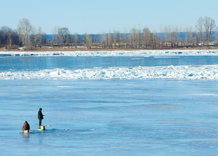 River flood fishermen. Torn river ice fishermen. River with the last ice fishermen on the ice. Russia Tatarstan Kama river in early spring