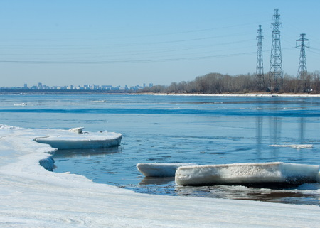 River With Broken Ice. ice hummocks on the river in spring. landscape close-up ice drift on the river in the spring on a sunny day Imagens