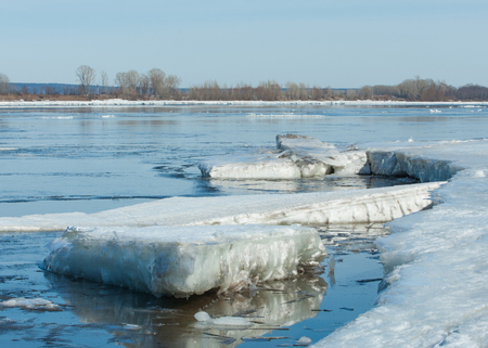 River With Broken Ice. ice hummocks on the river in spring. landscape close-up ice drift on the river in the spring on a sunny day Stock Photo