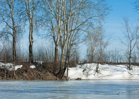 Frozen lake in the spring. spring ice Stock Photo