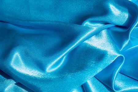 drapes: Texture, fabric, background. Abstract background of luxurious fabric or liquid waves or wavy grunge crease silk satin texture of velvet material or luxurious Christmas or elegant background. Blue Stock Photo