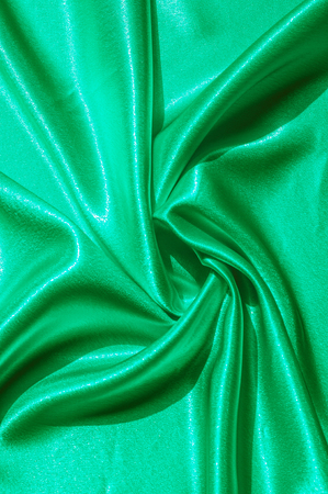 Texture, fabric, background. Abstract background of luxurious fabric or liquid waves or wavy grunge crease silk satin texture of velvet material or luxurious Christmas . green Stock Photo