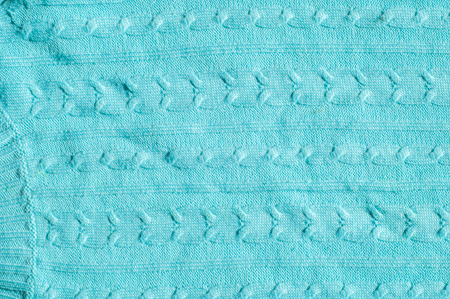 Texture, background, pattern. Womens woolen blue striped sweater