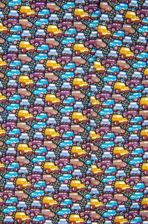 Texture, fabric, background. Cotton fabric. Cars coloring.  A lot of cars on a summer road roads.