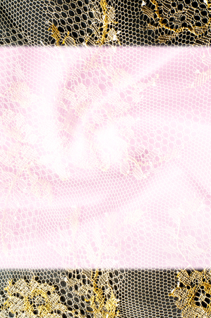 spandex: Image texture background, decorative gold lace with pattern. Golden vintage lacy background. Gold lace on a pink background. Spandex, macro. Lacy decorative floral pattern.