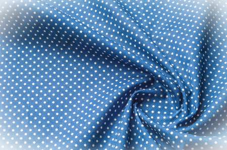 Texture background pattern. Silk fabric, blue cloth in white peas. On a black background. Flower textile or fabric. Texture of fabric. Fabric, textiles, fabric, material, woven.