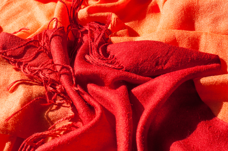 Texture, background, pattern. Red woolen female scarf