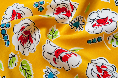 Texture background pattern. floral pattern on a yellow background. Textile template with floral ornament useful as a background. Flower textile or fabric. Texture of fabric. Fabric, textiles, fabric, material, woven. Stock Photo