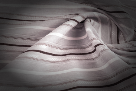 Texture, background, pattern. Woolen fabric is pale pink, striped. Desktop wallpapers in the open air and a vacation with a picture. Black and white fabric fabric lines.