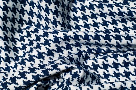 Texture, fabric, background. Fabric crochet pattern blue diamond pattern on white background