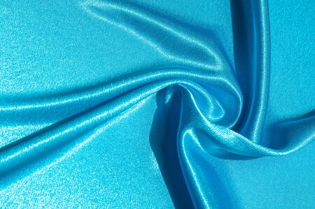 Texture, fabric, background. Abstract background of luxurious fabric or liquid waves or wavy grunge crease silk satin texture of velvet material or luxurious Christmas or elegant background. Blue Stock Photo