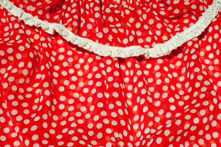 Texture, background, pattern. Womens dress. Cotton fabric is red with a green pea Stock Photo