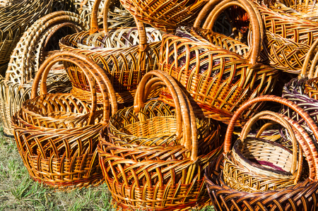 interleaved: Wicker baskets made of willow twigs.  close-up wicker baskets and other items made from natural materials
