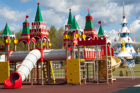 Texture of the background image, spring landscape, Childrens play complex. Childrens playground in the spring. Multifunctional childrens game complex in the open air. Stock Photo