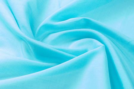 Texture background of fabric. Silk blue fabric, aqua, blue, Bondi blue, sky blue, blue blue, pink egg blue, Skobelov, turquoise, flower names. Smooth elegant blue silk or satin can be used as a background
