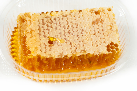 beeswax: Cellular. Honey. The structure of hexagonal cells of wax, made by bees for storing honey and eggs.