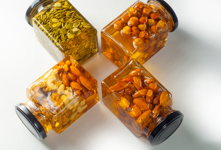 nutshells: Honey with nuts closed in jars. Good for your health