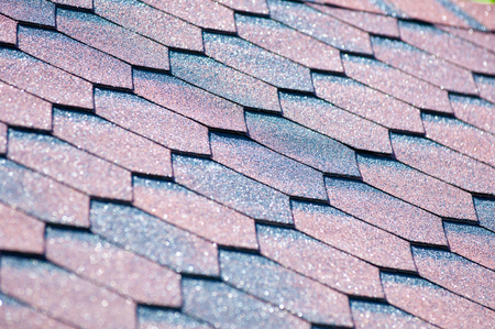 An asphalt shingle is a type of wall or roof shingle that uses asphalt for waterproofing. They are one of the most commonly used roofing covers in North America Stock Photo - 81284433