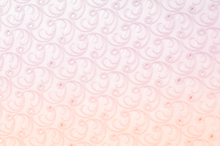 Texture background of fabric. Cloth with perforated circles. The texture of the fabric is painted in pastel tones of pink color, close-up of a pink cotton cloth texture background in pastel colors. Reklamní fotografie