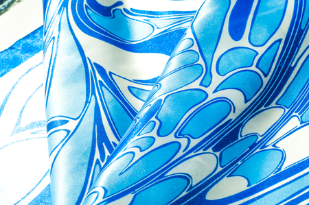 Texture, background, pattern. A womans silk handkerchief. Shawl abstract pattern, blue patterns on a white background Stock Photo