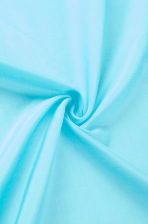 Texture background of fabric. Silk blue fabric, aqua, blue, Bondi blue, sky blue, blue blue, pink egg blue, Skobelov, turquoise, flower names. Smooth elegant blue silk or satin can be used as a background