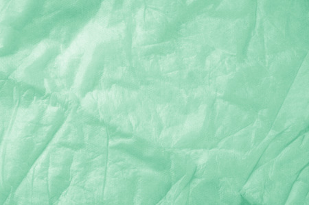Texture of fabric background. Cotton green cloth. Light airy fabric. Green fabric background, wedding, valentine, attraction, theme anniversary Stock Photo