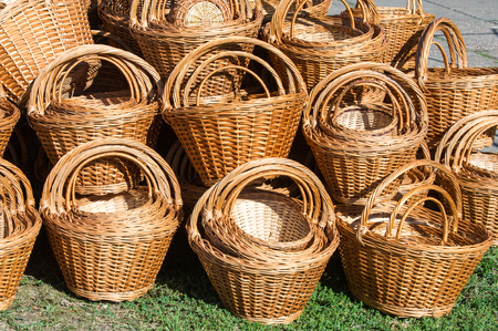 interleaved: Background texture. Wicker baskets made of willow twigs.  close-up wicker baskets and other items made from natural materials