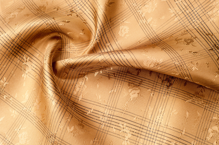 Texture background pattern. Silk fabric is brown, chocolate with milky color, carnelian, burnt sienna, flame, lust, persimmon, color. Abstract luxury fabric background or liquid waves or wavy grunge folds Stock Photo