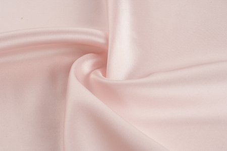 Texture, background, pattern. Fabric silk pink background. Beautiful pink satin. Drapery background. winds waves, creating a beautiful background of the folds. Stock Photo