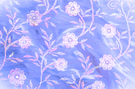 refinement: Texture, background, pattern. Pink lace decorated with flowers on a blue background. Background of pink, blue, beautifully decorated with flowers. pattern with pink lace on the blue background Stock Photo