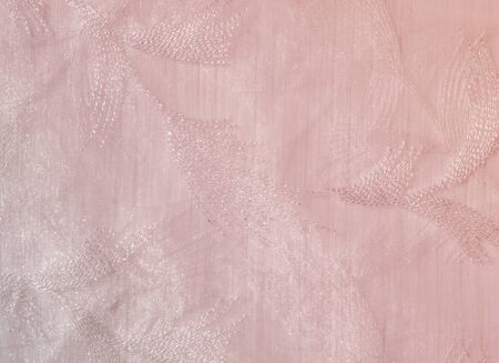 pale colors: Texture, background, pattern. Tulle of pastel pink tones. Abstract background of pink fabric. Soft texture of the fabric, pink pastel tone. Shabby chic style. Crumpled tulle as a background.