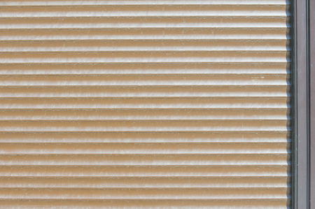 jalousie: Background pattern, texture. Protective blinds - metal, external, external. Closed blinds for use in the background. Roller shutters, window shutters