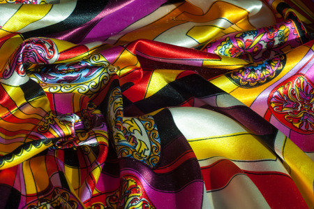 Textur, Hintergrund, Muster. Stoff Seide abstrakte Muster. Bestehend im Denken oder als Idee. Gewebter oder Filzstoff aus Wolle, Baumwolle oder ähnlichen Fasern. Standard-Bild
