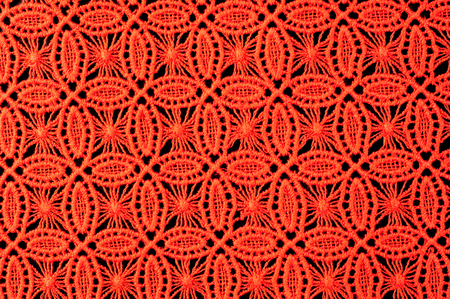 ornamentations: Image texture background, Detail of woven woolen texture of design and lace. Red fabric background. Decorative lace with a pattern. Red texture of lace fabric Photo taken in studio Stock Photo