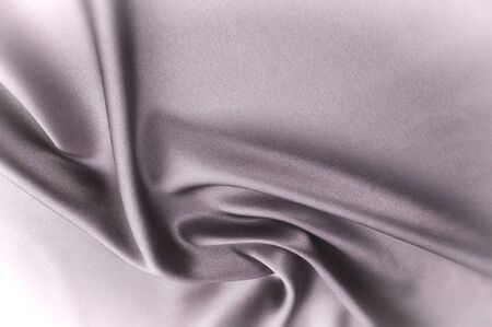 silky velvet: Texture fabric background. Black white silk fabric. Fragment of an abstract background of luxurious fabrics or liquid waves or wavy folds of a grunge silk texture of a satin velvet material