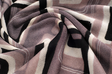 Texture, pattern, background. Cloth knitted - painted squares, gray white black. This one-sided stretch knit, very liquid fabric with the weight of clothing