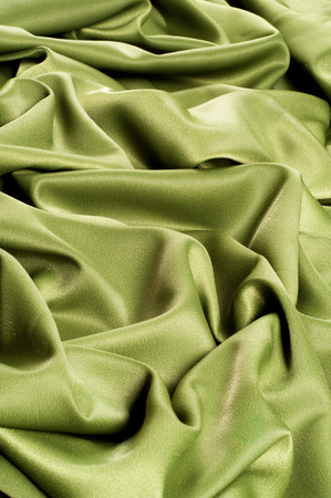 Texture, background. template. Cloth silk green, crepe de Chine. a fine crepe of silk or similar fiber. Stock Photo