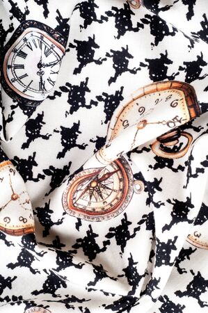 Texture, fabric, background. Texture of female dress white with black figures, cotton cloth with a clock pattern