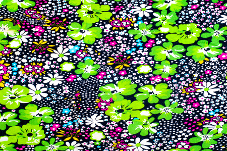 Background texture, drawing. Weaving cotton. Multicolored flowers on a black background. FIELD FLOWERS in the color option BLACK. This seal is just beautiful!