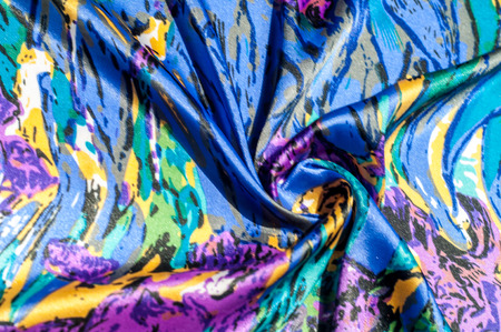 convenient: Gaussian blur is convenient for designers Texture, fabric, background. Womens scarf. Silk fabric is blue, floral pattern. Abstraction