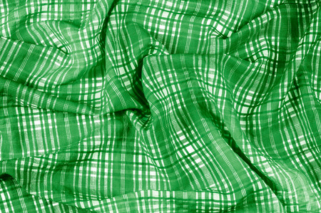 background texture. silk fabric checkered green white. beautiful silk taffeta-twill with wicker check in the eternal bell of green and orchid.