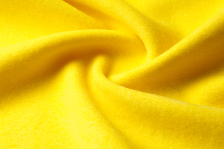 matting: Texture background pattern. Woolen yellow fabric, cloth for a blanket, outer clothing.  Closeup horizontal fragment