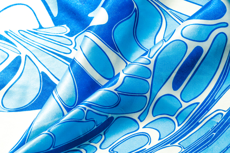 head scarf: Texture, background, pattern. A womans silk handkerchief. Shawl abstract pattern, blue patterns on a white background Stock Photo